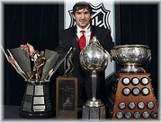 Washington Capitals hockey player Alex Ovechkin, of Russia , poses with, from left, the Rocket Richard, Lester B. Pearson, Hart and Art Ross trophies after winning them at the NHL awards ceremony in Toronto on Thursday June 12, 2008. © www.examiner.com